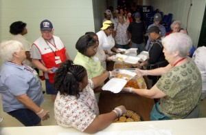 Volunteers with the American Red Cross in Meridian serve meals to Gustav evacuees in the Frank Cochran Center Monday. (AP Photo/The Meridian Star, Paula Merritt)