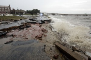 Pounding waves from Hurricane Gustav cause a beach road to collapse in Bay St. Louis. (AP Photo/Rogelio V. Solis)
